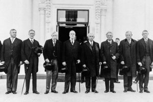 Supreme Court justices are shown posed together, Oct. 13, 1930.  From left to right:  William DeWitt Mitchell, attorney general; Harlan Stone, George Sutherland, Oliver Wendell Holmes, Chief Justice Charles Evan Hughes, Willis Van Devanter, Louis Brandeis, Pierce Butler, and Owen J. Roberts, newest associate justice.  The justices were on their way to pay a courtesy call at the White House to inform the president that the High Tribunal is now in session.  (AP Photo)
